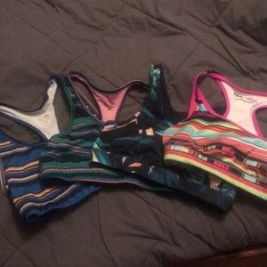 Sports bra, never worn !!! Selling all 4 together!